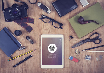Tablet with Scattered Objects on Wooden Background Mockup 2