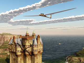 Segelflugzeug und schottisches Schloss am Meer
