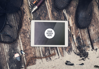 Tablet with Scattered Fishing Gear Mockup