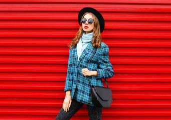 Fashion pretty young woman model wearing black hat coat jacket w