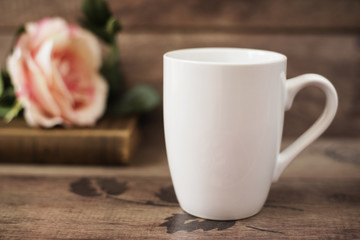 Mug Mockup. Coffee Cup Template. Coffee Mug Printing Design Template. White Mug Mockup, Old Book and Flower, Wooden Background. Blank Mug. Mockup Styled Stock Product Image