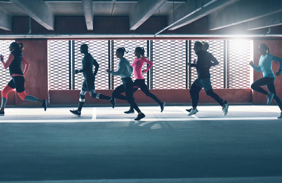 Group of diverse young people urban running