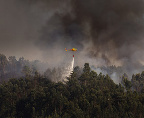 Portuguese Civil Protection Firefighter Helicopter Dropping Water on a Fire 4