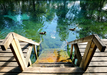 Wooden bridge for a swim in the lake