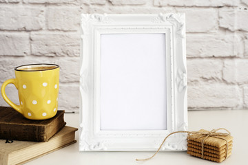 Frame Mockup. White Frame Mock Up. Yellow Cup Of Coffee With White Dots, Cappuccino, Latte, Old Books, Cookies. Display Mock-Up, Styled Stock Photography. Empty Rustic Frame.