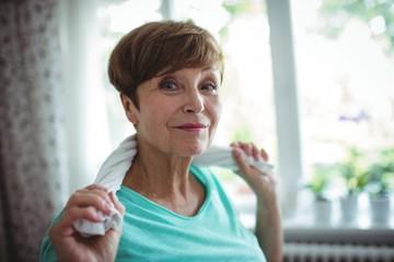 Senior woman holding towel around her neck