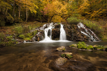Dokuzak waterfall in Strandja mountain, Bulgaria during autumn. Beautiful view of a river with an waterfall in the forest. Autumn landscape