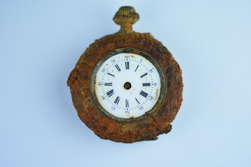 Old clock ,face with roman numerals
