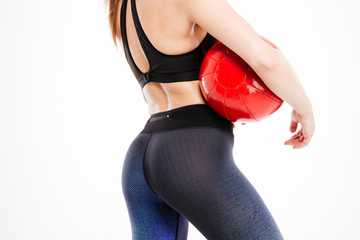 Cropped image of a sexy women body holding red ball