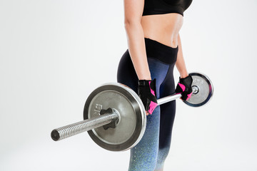 Cropped image of a young woman with barbell