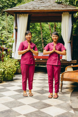 Two women massage therapist welcoming guest at spa,