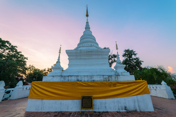 Sunset scence of White pagoda at Wat Phra That Khao Noi, Nan Province, Thailand