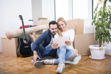 Young couple redecorating plans
