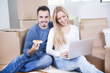 Young couple moving home and relaxing