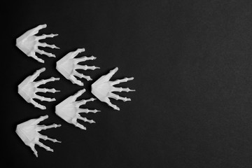 Halloween Black background with White skeleton hands show arrow