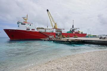 Cargo ship moored to a wharf, atoll of Rangiroa, Tuamotu archipelago, French Polynesia