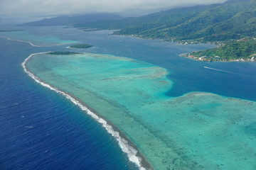 The lagoon and barrier reef of Raiatea island, aerial view, south Pacific ocean, Society islands, French Polynesia