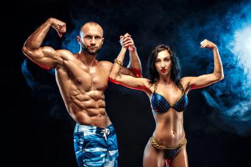 Shirtless Muscle Man Posing With Gorgeous Bikini Woman