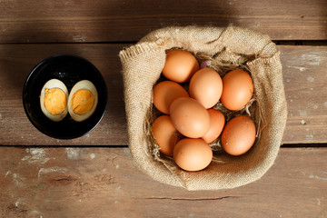 Fresh eggs on a wooden rustic background.