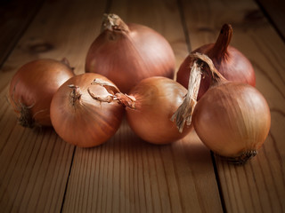 Brown onion on a wooden table