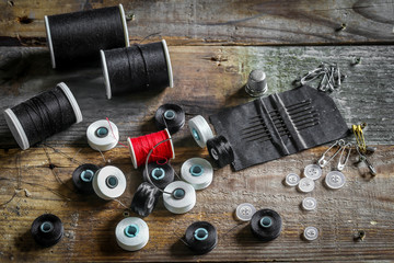 set of sewing threads and accessories on wooden background