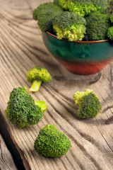 Healthy Green Organic Raw Broccoli Ready for Cooking.on wooden table.selective focus