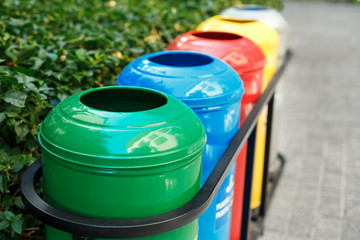 Colored trash containers for garbage separation