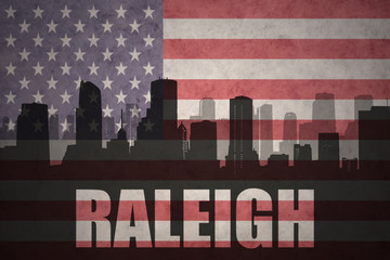 abstract silhouette of the city with text Raleigh at the vintage american flag