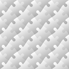 Jigsaw puzzle mosaic seamless background. Each of puzzle pieces in diagonal arrangement has own grey gradient. Simple flat vector illustration.