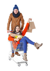 Young man carrying woman in trolley isolated on white