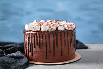Tasty chocolate cake with marshmallow on table