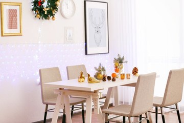 Room with table and chairs decorated for Christmas