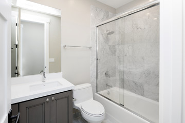 New Bathroom with marble and glass shower.