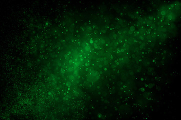 Dark green abstract background with bokeh.