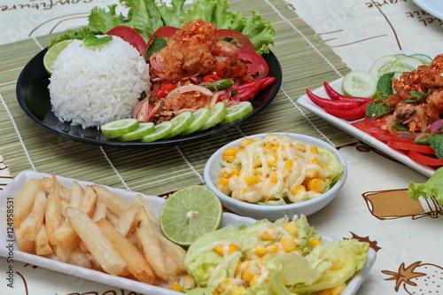 Close up Jasmine rice with spicy fried chicken salad (Khao Yum Kai Zap ...