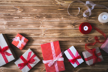 Christmas presents on a wooden background, candle.