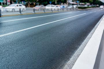 empty asphalt road through modern city in China.