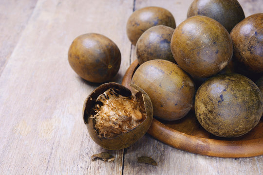 luo han guo (monk fruit, fructus momordicae, momordica grosvenori, siraitia grosvenorii) on wooden background.