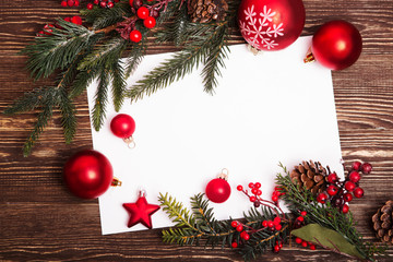 Christmas greeting card or photo frame over wooden table. View from above