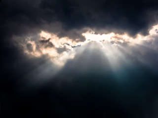 Sun Rays through Dark Clouds
