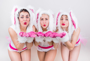 Group of beautiful girls in rabbit costume send kiss putting the