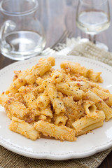 pasta with sauce and black pepper on white plate