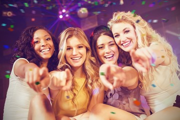 Composite image of pretty girls pointing with finger