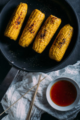 Grilled corn with spicy sauce