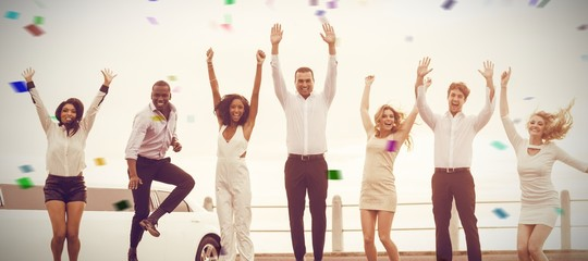 Composite image of well dressed people jumping next to limousine
