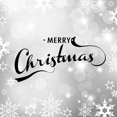 Christmas silver background with snowflakes and Merry Christmas
