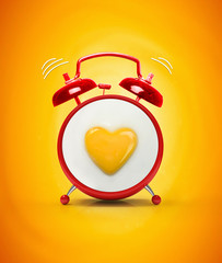 Red alarm clock and fried fried eggs with yolk heart. The original creative idea concept omelette breakfast. Beautiful bright yellow background.