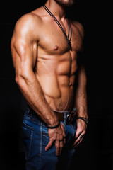 Muscular and sexy torso of young man with perfect abs. Athletic body of male hunk. Fitness concept