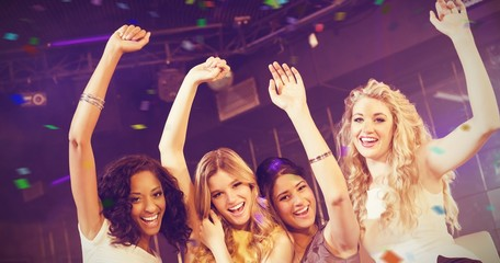 Composite image of pretty girls with arms up