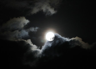 Full Hunter's Moon with clouds atmospheric spooky night time photo